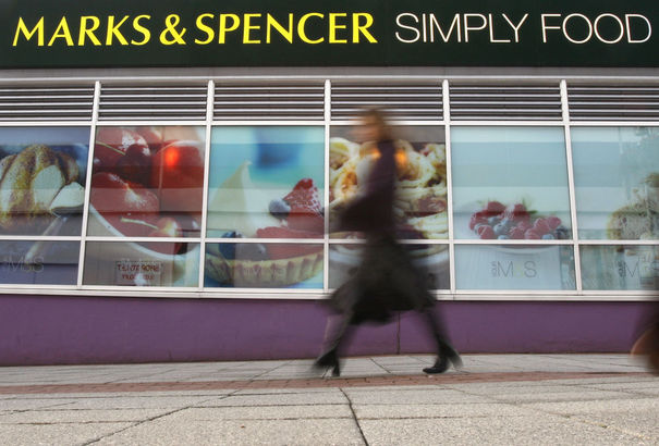 64881_a-woman-walks-past-a-marks-and-spencer-food-store-in-loughborough-central-england